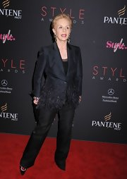 Carolina Herrera's black pantsuit at the Style Awards was made ultra-feminine by feather embellishments.