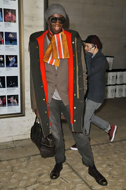 J. Alexander kept warm and stylish in a bright orange silk scar during New York Fashion Week.