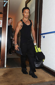 British singer Aston Merrygold rocked a pair of black leather lace up boots, sans laces. The on trend boots toughen up a black tank and baggy pants.