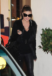 "Fergie donned a pair of futuristic shades reminiscent of ""Batman"" after an appearance on ""X-Factor."""