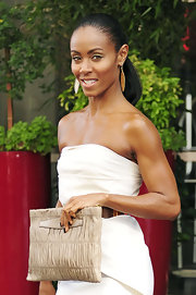 Jada looked bright and sexy in a strapless, belted Fendi dress with dangling gold earrings.