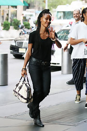 Jada Pinkett Smith was spotted at the Mandarin Hotel in NYC wearing a pair of black leather ankle boots. She donned the classic footwear over a pair of matching skinny jeans.