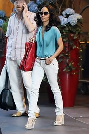 "Jada Pinkett Smith looked sharp in her white ""Midge Elgin"" jeans."