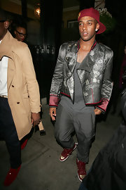 Oritse Williams wore an eye-catching ensemble topped off with a gray and purple satin cropped jacket.