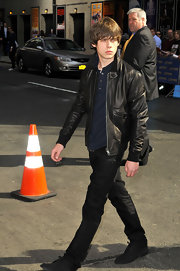 Jake Bugg channeled his inner bad boy when he sported this cool black bomber.