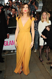 Kristen was ultra-glam at the Glamour Awards in a yellow faux-wrap evening dress with sequined shoulders.