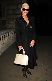 Brigitte Nielsen's cream handbag looked timeless at London Fashion Week.