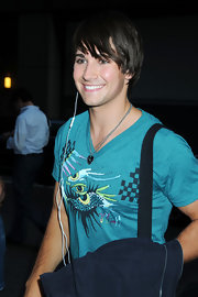 James Maslow is rarely spotted without his favorite silver guitar pick necklace. Maybe it brings the singer luck?