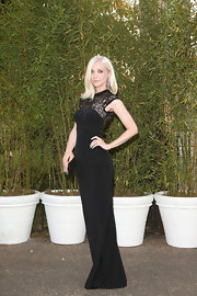 Portia Freeman looked sleek and elegant in this black gown that featured lace detailing at the neck and sleeves.