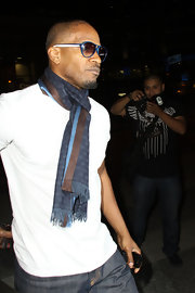 Jamie complemented his designer scarf with blue Cochran shades.