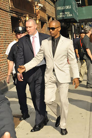 Jamie Foxx looked summer chic in a cream, two-button, notch-lapeled suit.