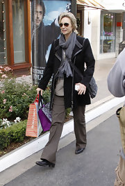 Jane Lynch went Christmas shopping in a leather-trimmed black wool coat.