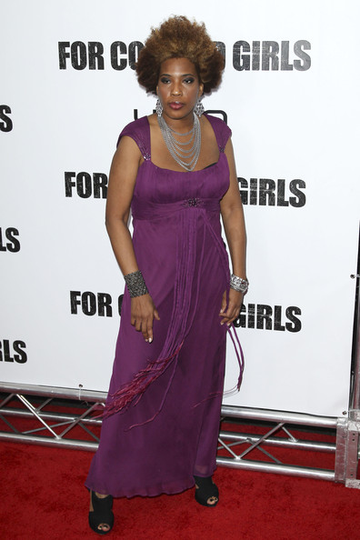 With her ever unique approach to fashion, Macy Gray wears a purple floor length chiffon gown with cap sleeves and an interesting fringe feature at her empire waistline.