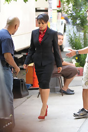 Janet wore a chic business skirt suit with sexy Big Lips pumps.