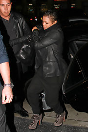 Janet Jackson looks cool as ever in chic lace up ankle boots. The gray suede boots brighten up Janet's all-black attire.
