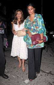 Eva Mendes left the after-party for the film 'Horrible Bosses' in New York City holding a beige clutch leather purse.