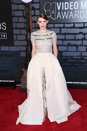 Holland Roden couldn't decide between pants or a gown, so she went for both when she wore this flowing ball gown paired over matching cigarette pants.