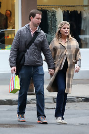Jenna Bush Hager stepped out covering her baby bump with this brown plaid wool coat.