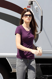 Jennifer Carpenter wore modernized cat eye sunglasses with translucent lenses.