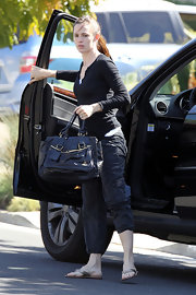 "A fresh-faced Jennifer sported a casual look with the black leather ""Bay Bag"". The handbag features gold hardware and a double strapped top handle. With the many compartments, this bag features plenty of room to carry all of her mommy needs."