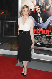 Greta Gerwig maintained her black-and-white look with toe-revealing black patent pumps with dainty nude ankle straps.