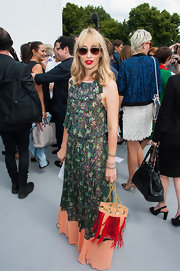 Alexandra Golovanoff chose a retro-inspired floral-printed maxi dress while out at the Dior Haute Couture show.