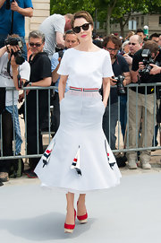 Ulyana kept her look classic and chic by pairing her bold skirt with a white top.