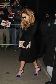 Jennifer Lopez added a pop of color to her look with purple satin peep-toe pumps.