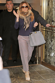Jennifer Lopez disguised her famous figure in a pair of loose plaid trousers.