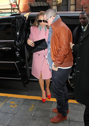 Jennifer Lopez topped off her pink coat with red satin platform pumps.