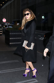 Jennifer Lopez looked mighty glamorous in this black fur-trimmed coat and purple heels while out in NYC.