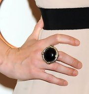 Jennifer Morrison matched the black waistband of her jumpsuit with this geometric black and gold decorative ring.