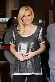 Jenny McCarthy showed a different way to incorporate sequins into a look on the set of 'Extra,' pairing a sparkly gunmetal sequined tunic with sleek black pants.