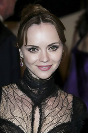 Christina Ricci brought out her best jewels for the Met Gala with 19th Century ruby and diamond pendant earrings in silver on gold.