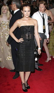 Leighton Meester mirrored her strapless cage dress with black patent cage booties.