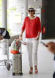 Jessica Alba rocked the easy-going tropical look when she sported this vibrant red sweater while leaving St. Barths.