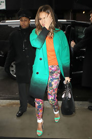 Jessica topped off her colorful ensemble with bright green platform sandals.