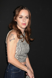Taryn Manning wore a sleeveless top to the Charlotte Ronson fashion show, putting her owl tattoo on show.