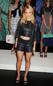 AnnaSophia Robb added a feminine touch to her edgy ensemble with a pair of black platform sandals.