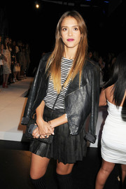 Jessica Alba sported an edgy schoolgirl vibe with this pleated black mini skirt and leather jacket combo at the Charlotte Ronson fashion show.