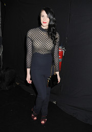 Kate Nash complemented her jumpsuit with an elegant black shoulder bag when she attended the Charlotte Ronson fashion show.