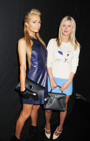 Nicky Hilton kept it casual and youthful in a cat-print crewneck sweater during the Charlotte Ronson fashion show.