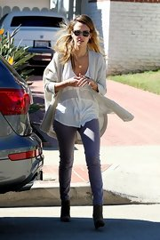 Jessica Alba adores this drapey lace tank—she always wears the sheer-paneled style layered with other cozy pieces.