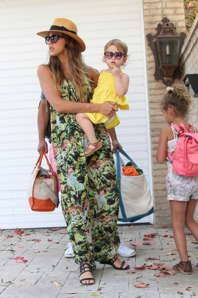 Jessica Alba sports a blue bikini as she enjoys a beach party with daughters Honor and Haven and husband Cash Warren in Malibu.