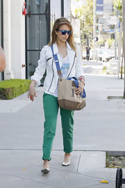 Jessica Alba chose a light-wash denim jacket with zipper detailing to add a dash of edge to her look.
