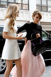Jessica Alba was spotted during Fashion Week carrying a vintage-chic black patent leather tote.