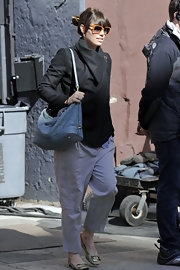 Jessica Biel may be famous for her curves, but she did everything she could to hide them in a pair of drop waist lavender pants.
