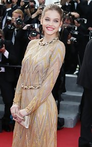 Barbara Palvin chose to carry a gold clutch that perfectly matched her outfit at the 'Lawless' premiere.