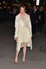 Emma Stone accessorized her chic glittering frock with metallic gold peep-toe pumps complete with knotted detailing.