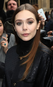 Elizabeth Olsen's nude lips topped off the star's minimal makeup look at Paris Fashion Week.